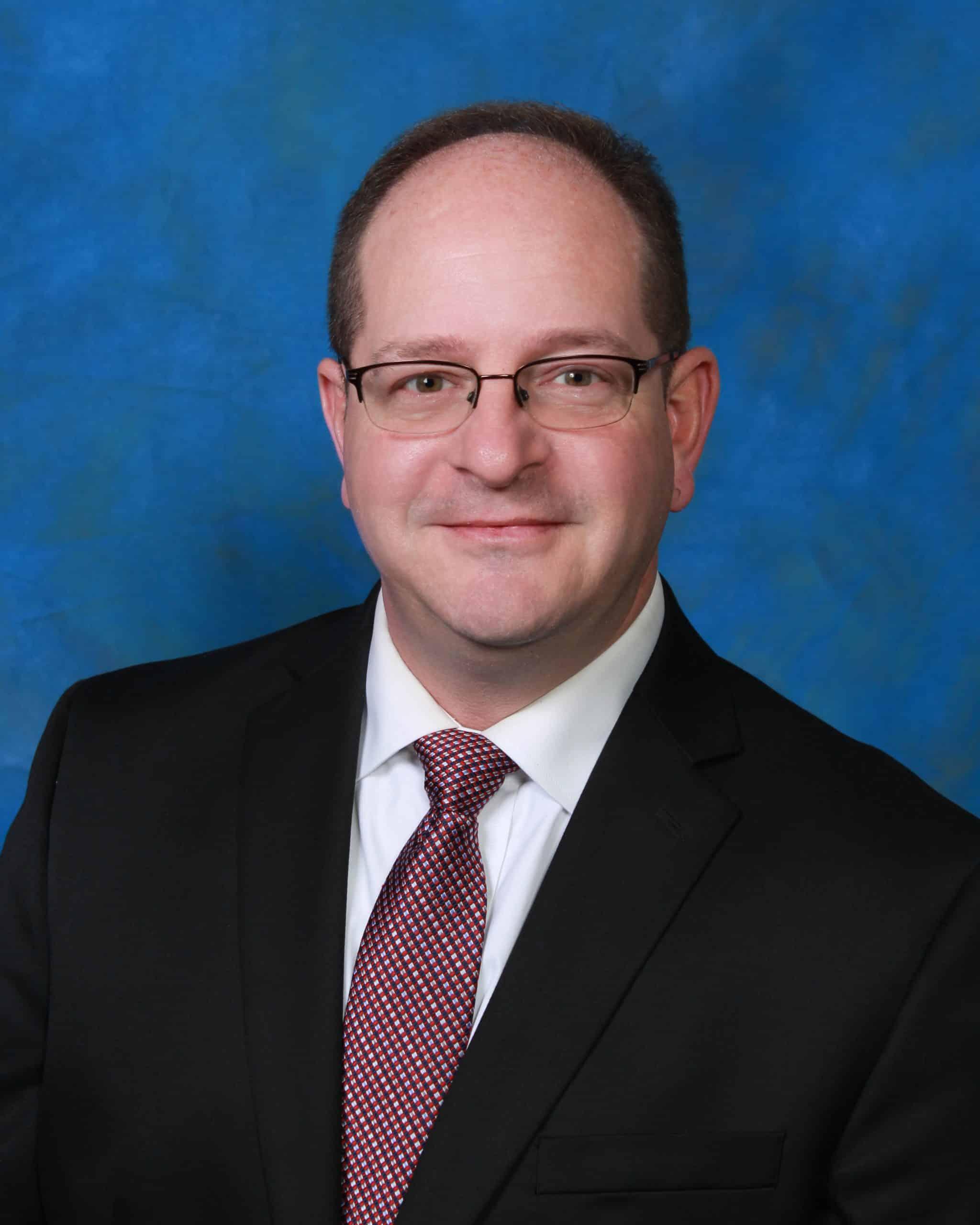 Headshot of Evansville criminal defense attorney Conor O'Daniel of the law firm Foster, O'Daniel, Hambidge & Lynch